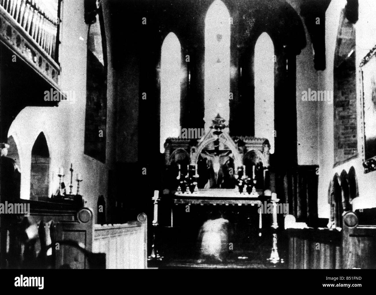 Ghost monk kneeling at altar - Stock Image