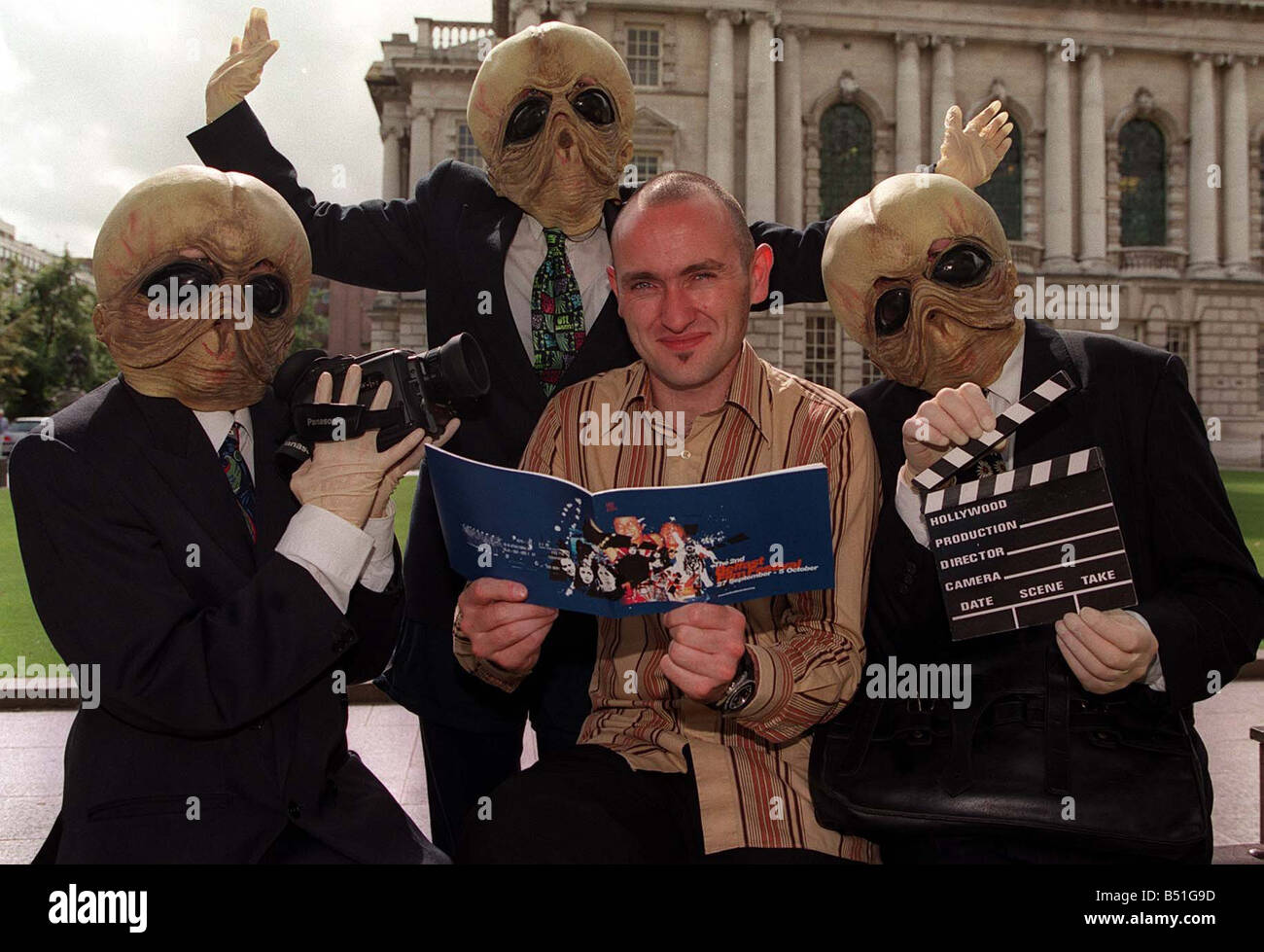 Launch Of This Years Belfast Film Festival Aug 2001 Aiden McLoone from Belfast Film Festival with the help of Alien - Stock Image