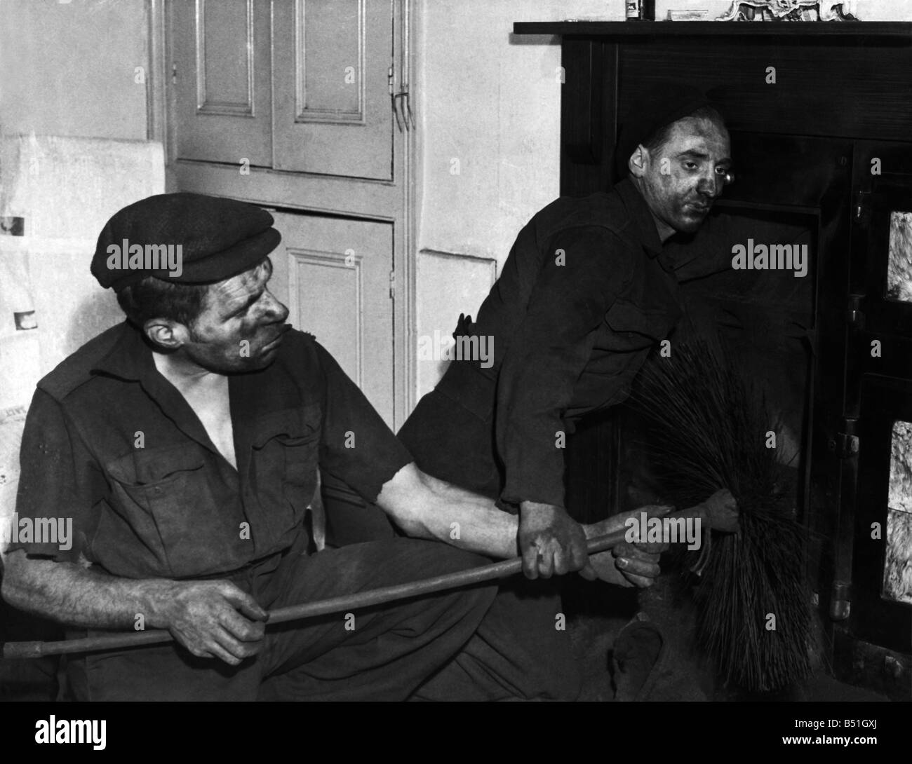 Chimney SweepsMr. Cuttriss (left) and Lionel who are working on a blocked up chimney. January - Stock Image