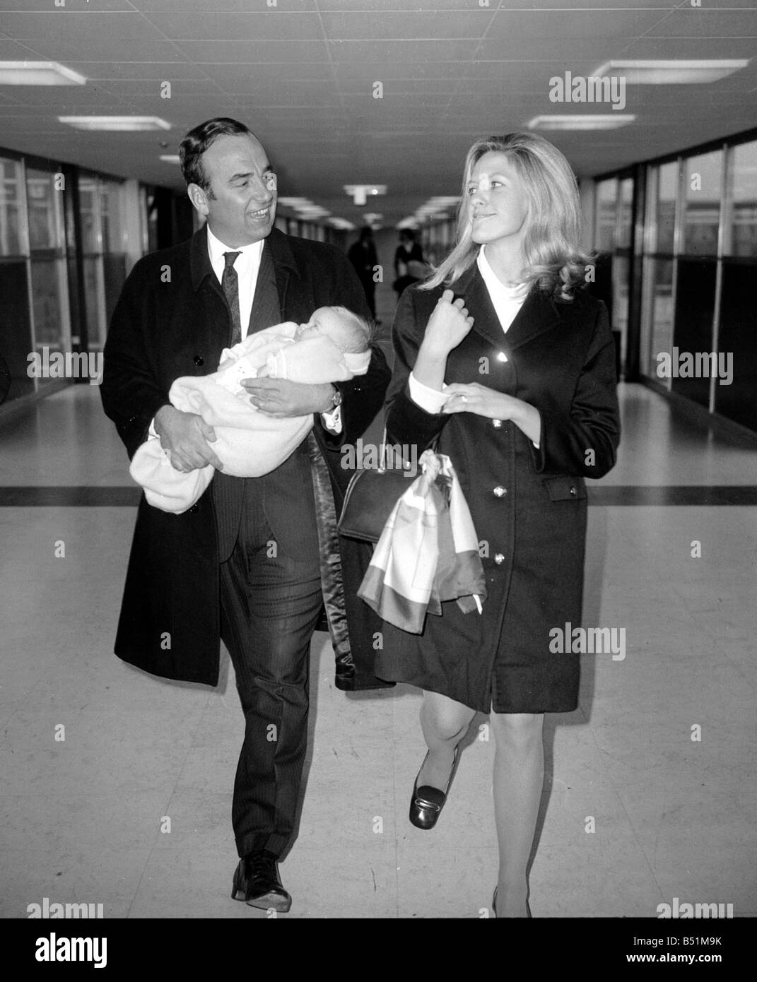 Rupert Murdoch with his wife Anna and their three month old daughter Elizabeth at Heathrow Airport arriving back - Stock Image