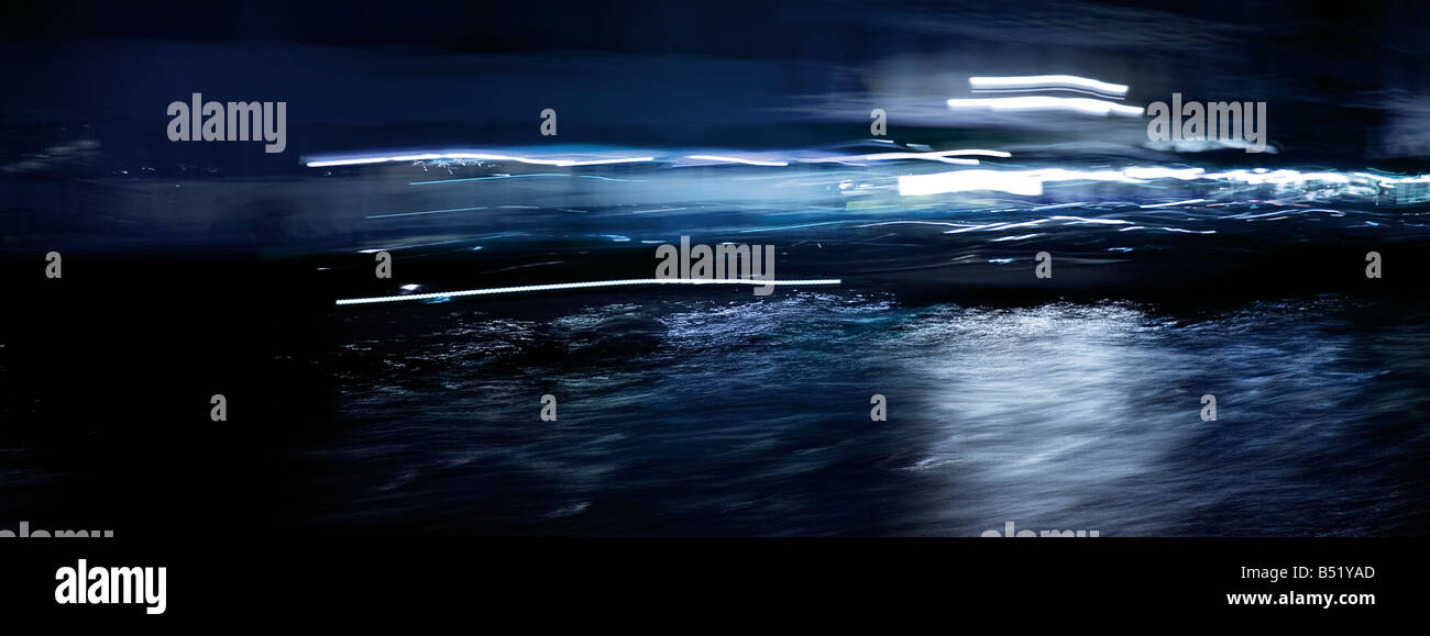 Venice in motion by night modern art photography taken from water bus on grand canal - Stock Image