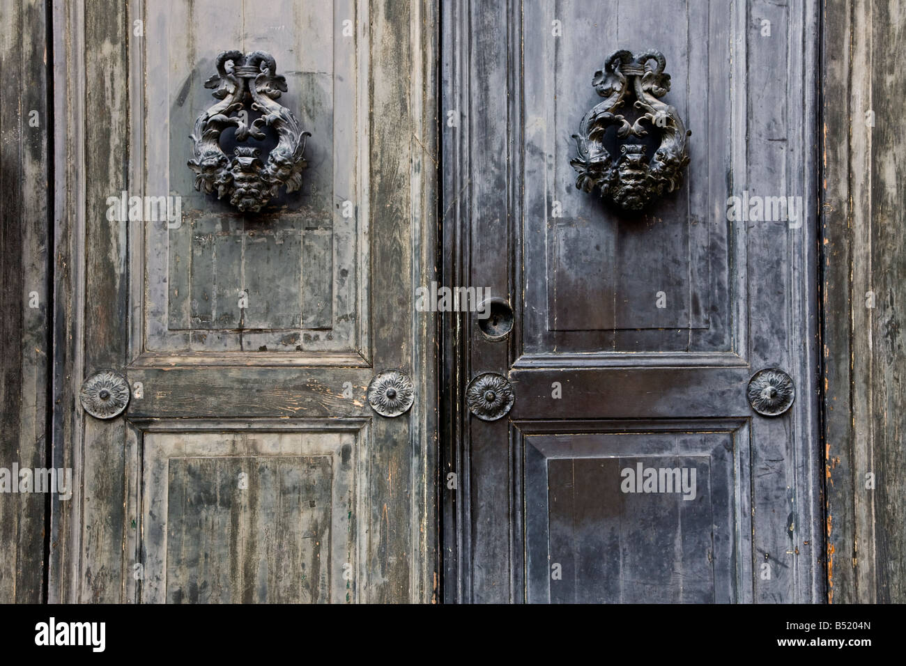 Venice Door With Ornate Door Knockers And Key Hole   Stock Image