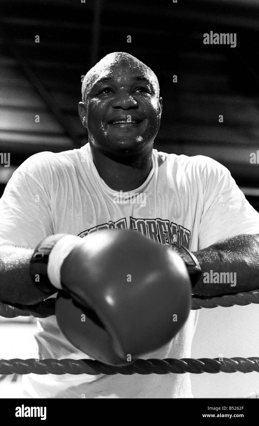 George Foreman Boxer In ring Leaning on ropes Dbase January 14th Marks the birthday of George Foreman former heavyweight - Stock Image
