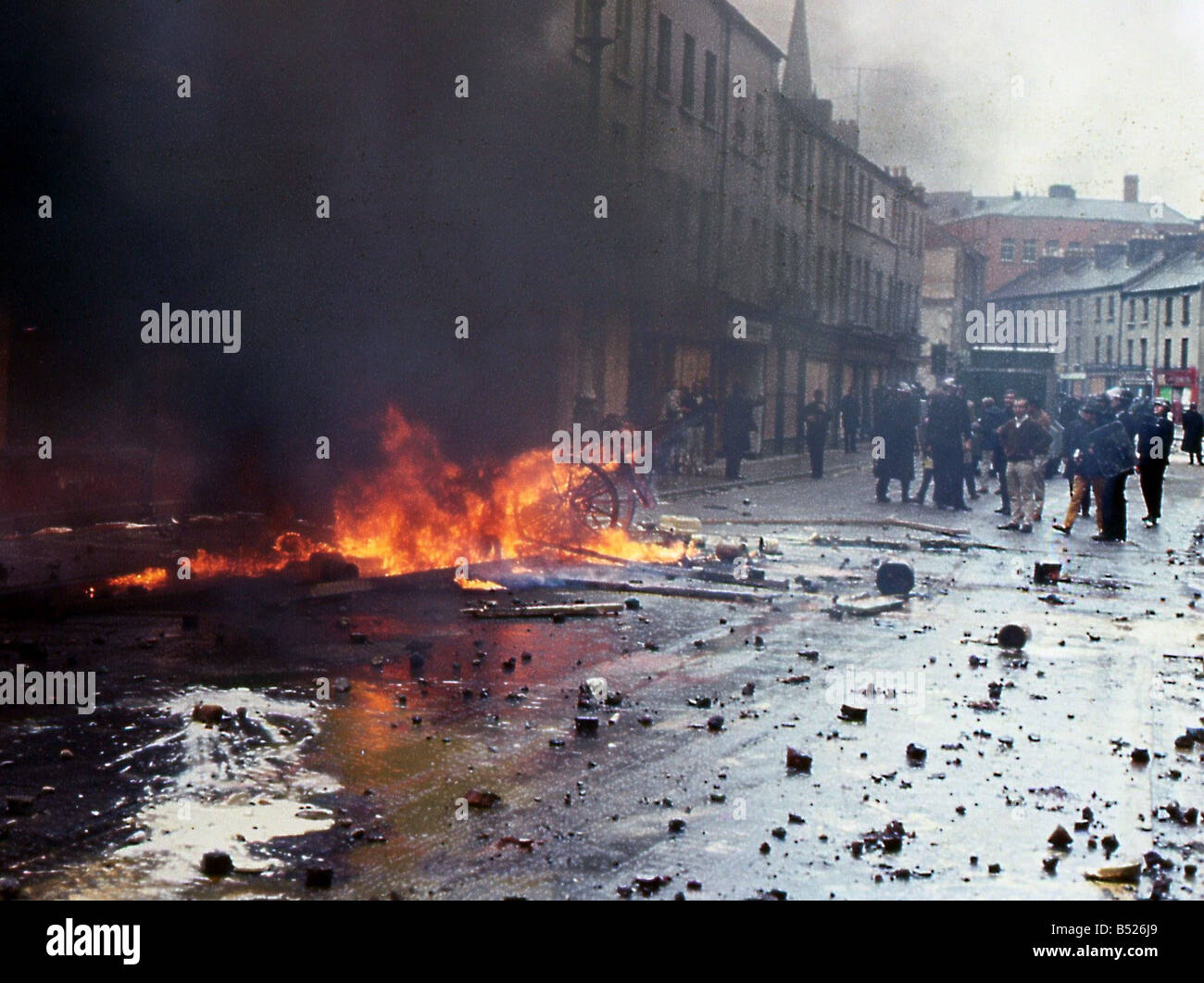 Northern Ireland Troubles 1969 Petrol bombs create fires as police & rioters clash in Londonderry after Apprentice - Stock Image
