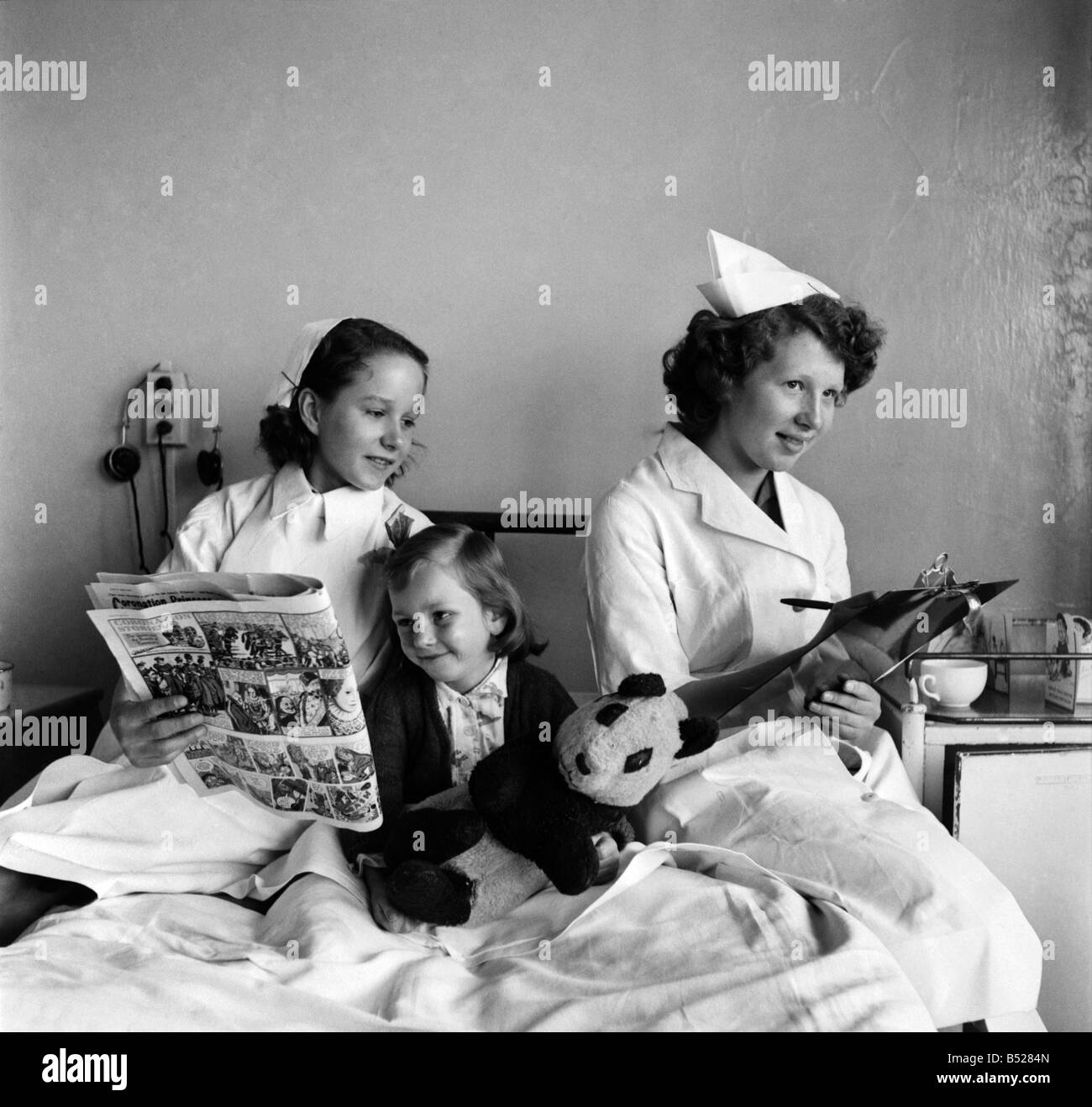 Teenagers doing work experience as nurses. The work experience scheme has been introduced to widen the choice of - Stock Image