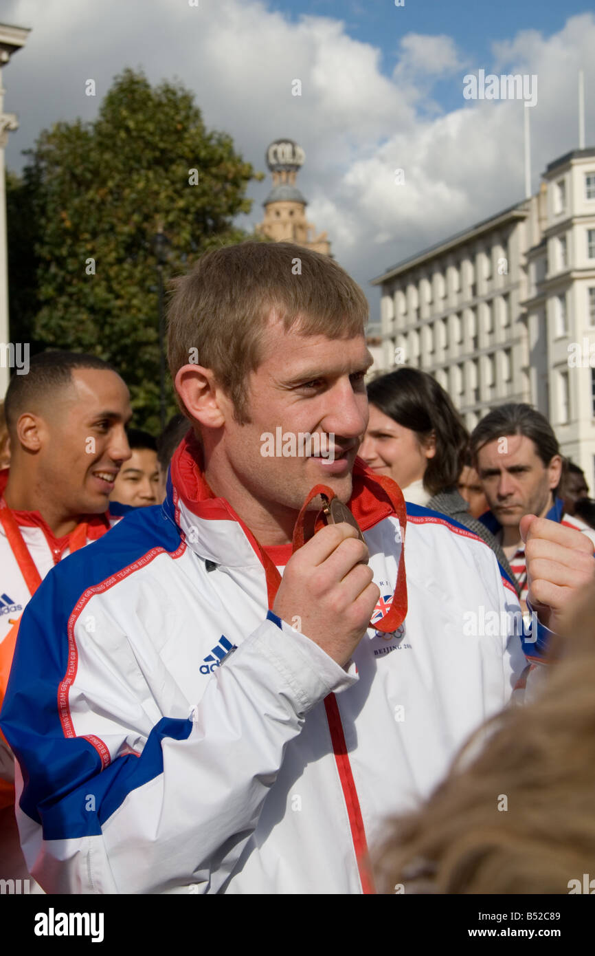 Beijing Olympics Boxing medallists, Tony Jeffries and James DeGale, mix with the crowd after the Victory Parade, - Stock Image