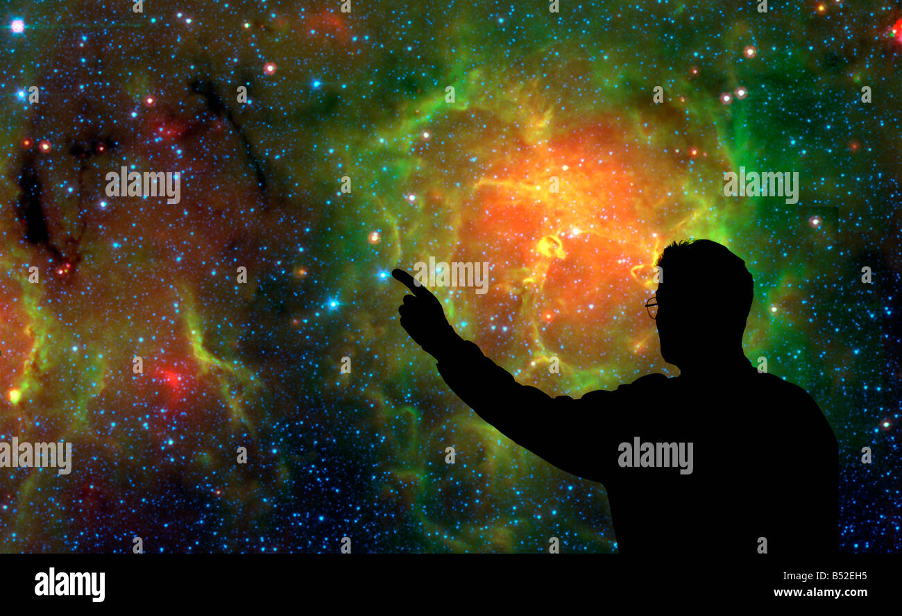 astronomy instructor studying galaxy of stars - Stock Image