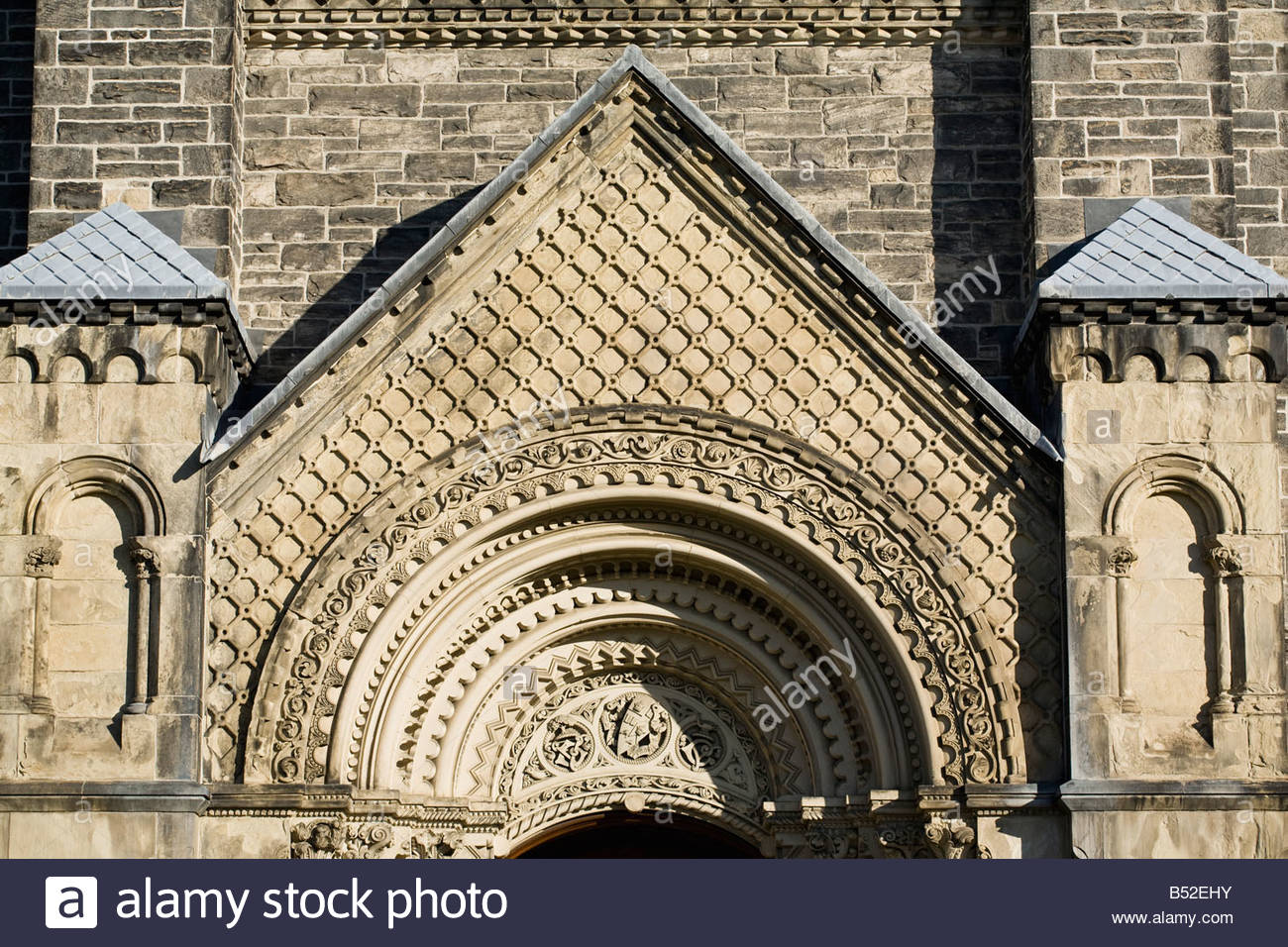 Compound arched doorway of University College at the University of Toronto in Toronto Ontario Canada - Stock Image