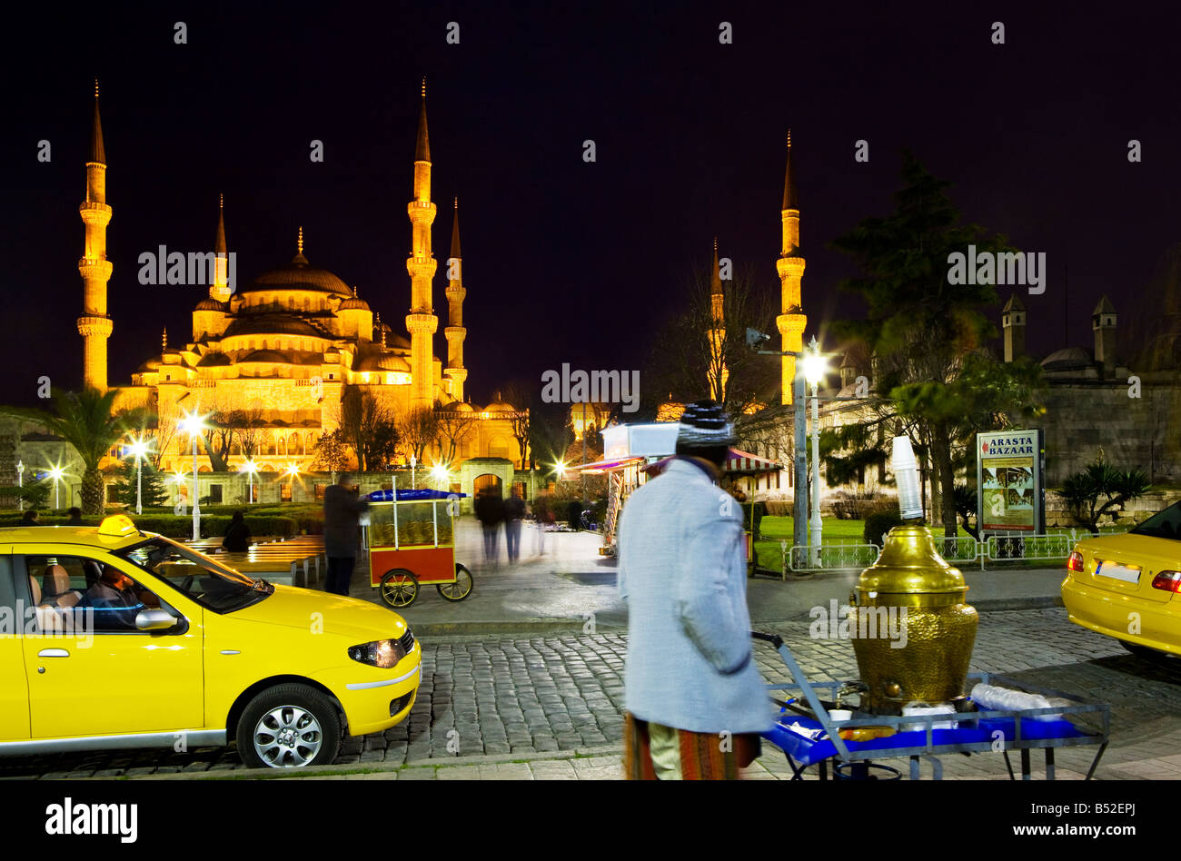 Taxi drivers wait along with simit Turkish bagels and tea vendors in front of the Blue Mosque. Turkey, Istanbul, Stock Photo