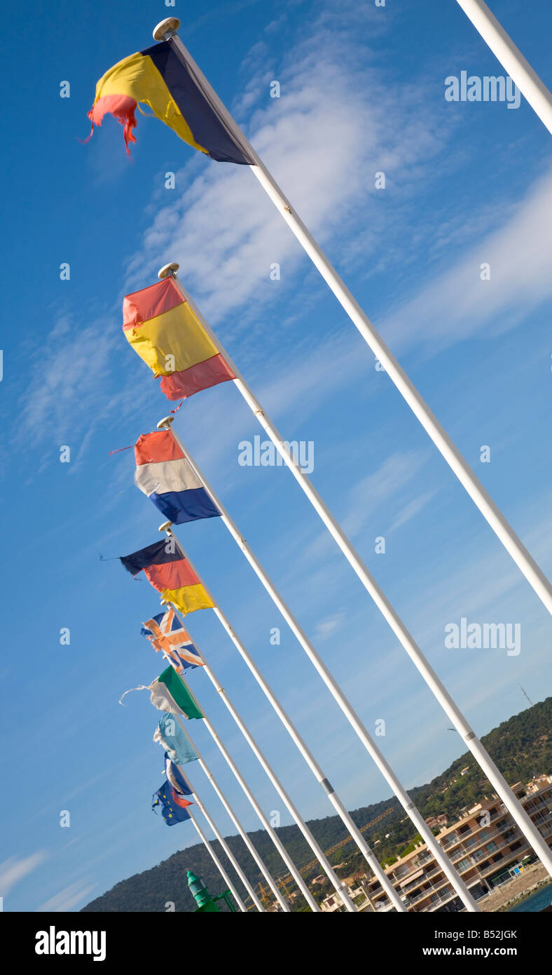Tattered European flags wave in the wind at the sea mole of Sainte-Maxime / Cote d'Azur / Provence / France - Stock Image