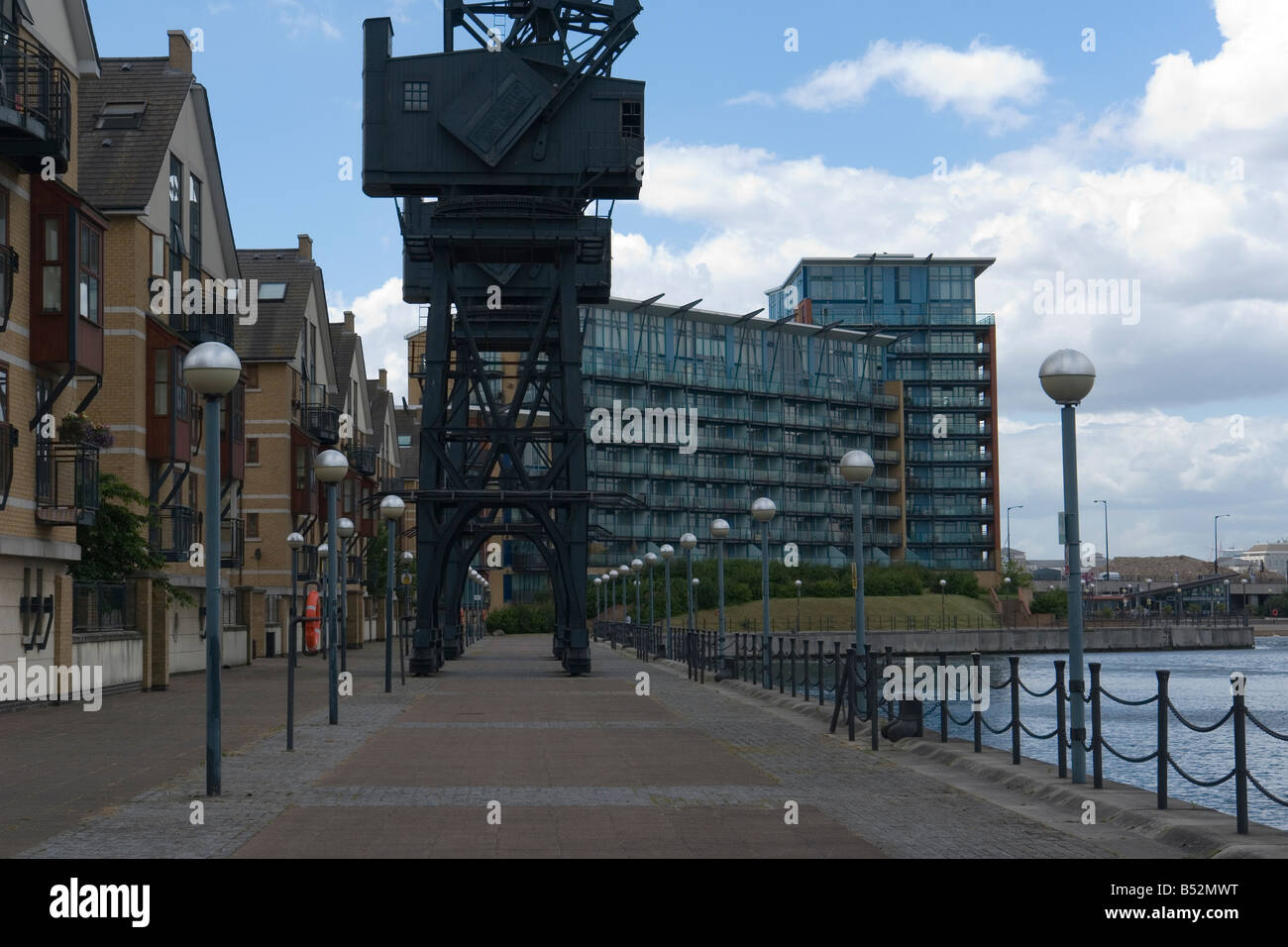 old cranes in front of the Britannia Village on the Royal Victoria Dock - Silvertown - East London - UK - Stock Image