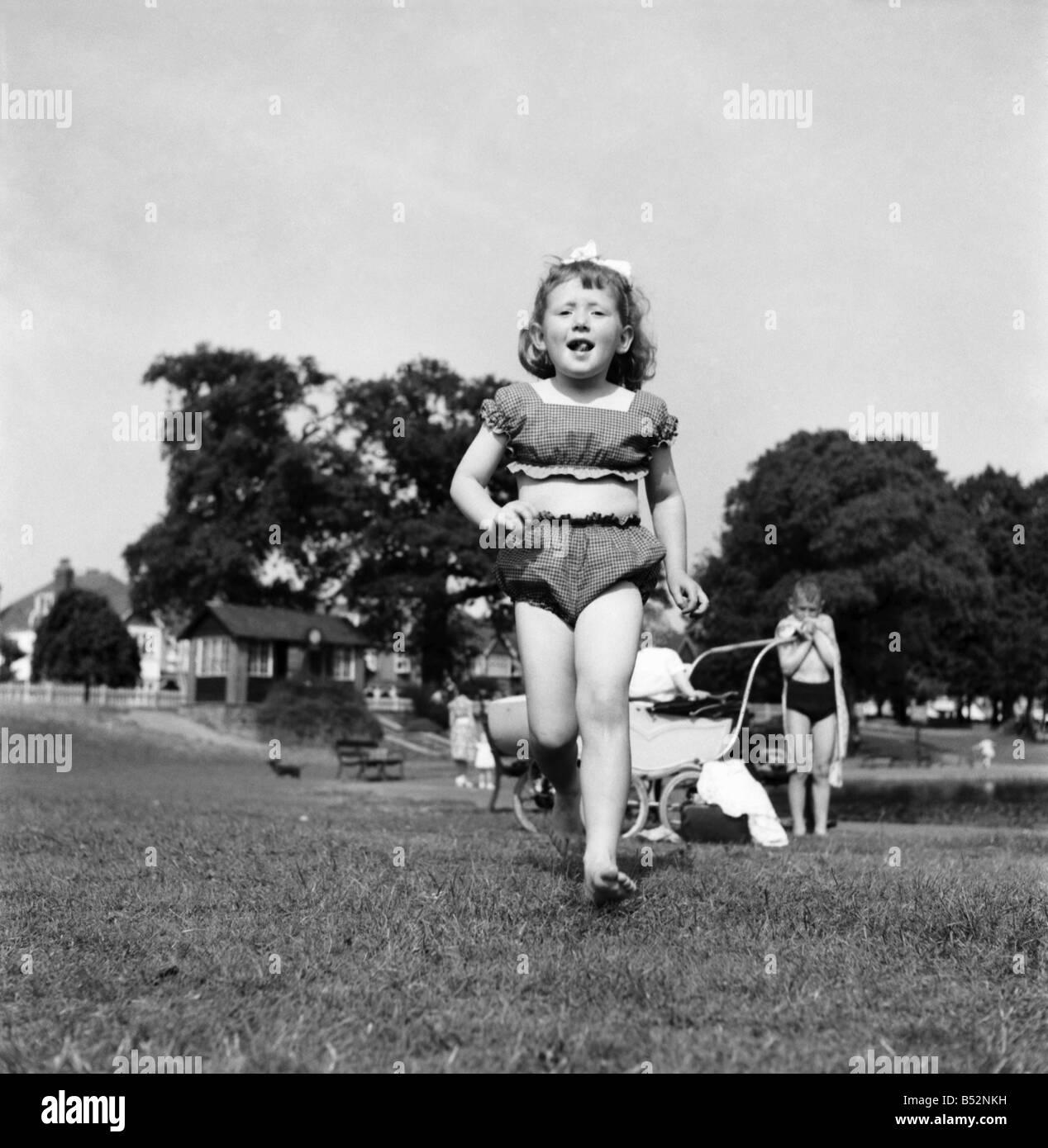 0eded2317385a Holidays, little girl modelling swimsuit. June 1953 D3299-004&