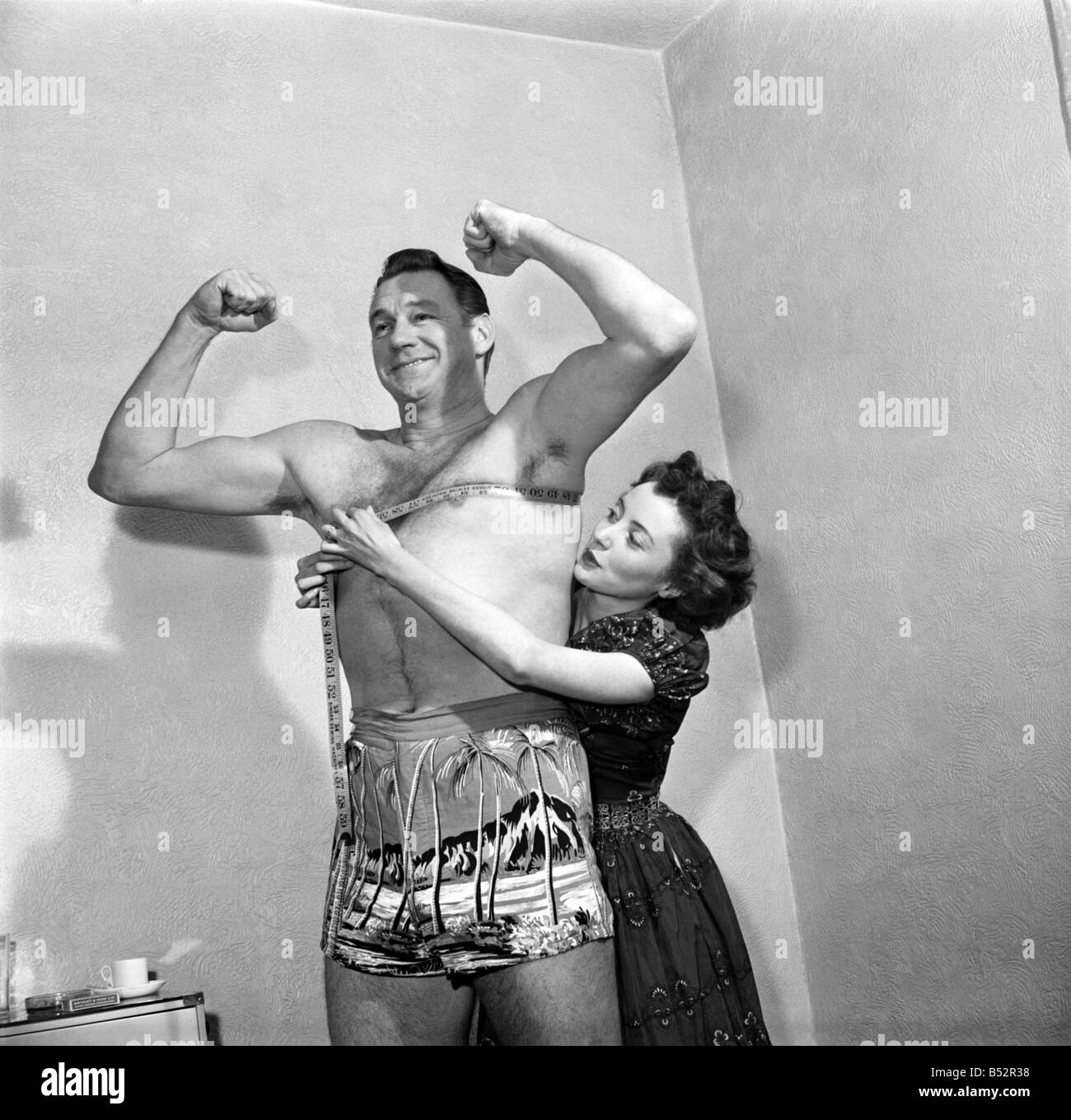 American film actress Brenda Hogan and actor Sonny Tufts pose. May 1952 C2299 Stock Photo