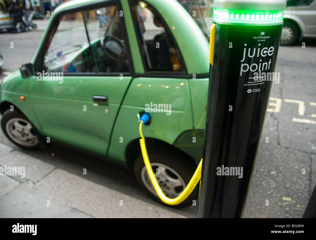 A G Wiz electric car charging from a City of Westminster Juice point in central London Stock Photo