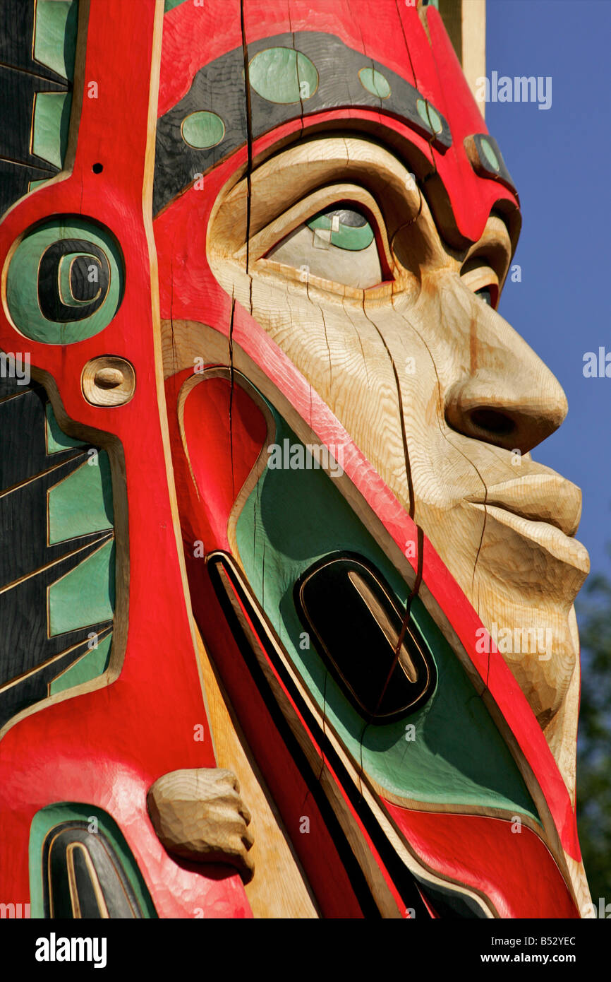 Close up of a face on a traditional Haida totem carving in Ketchikan, Alaska - Stock Image