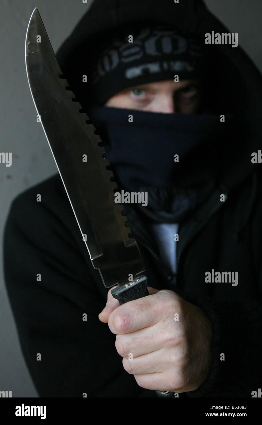 man holding knife - Stock Image