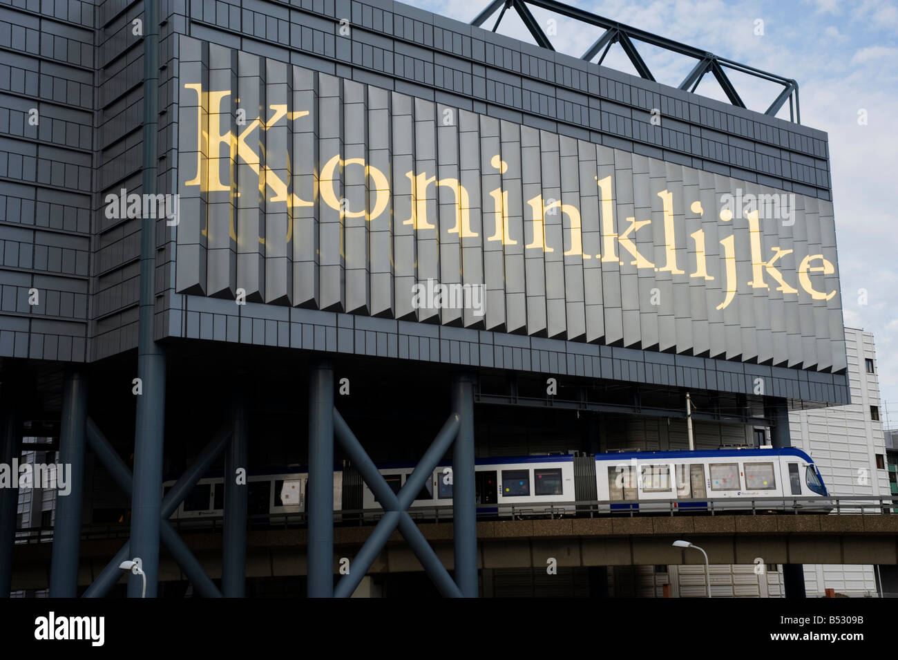 Tram passing below modern Koninklijke library in centre of The Hague in Netherlands 2008 - Stock Image