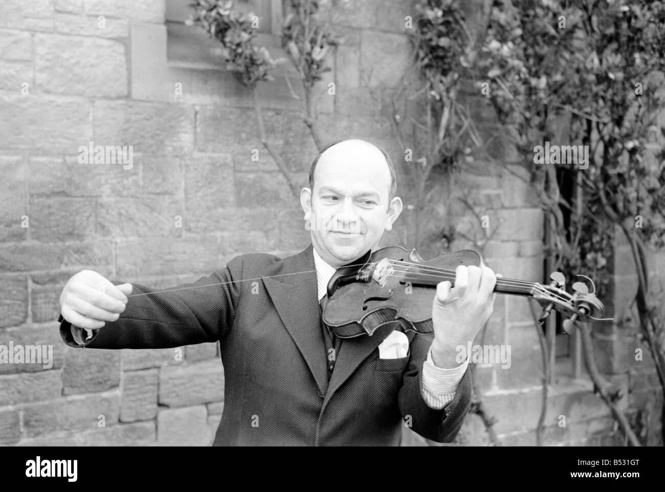 Man repairs strings on violin. January 1939 OL304G - Stock Image