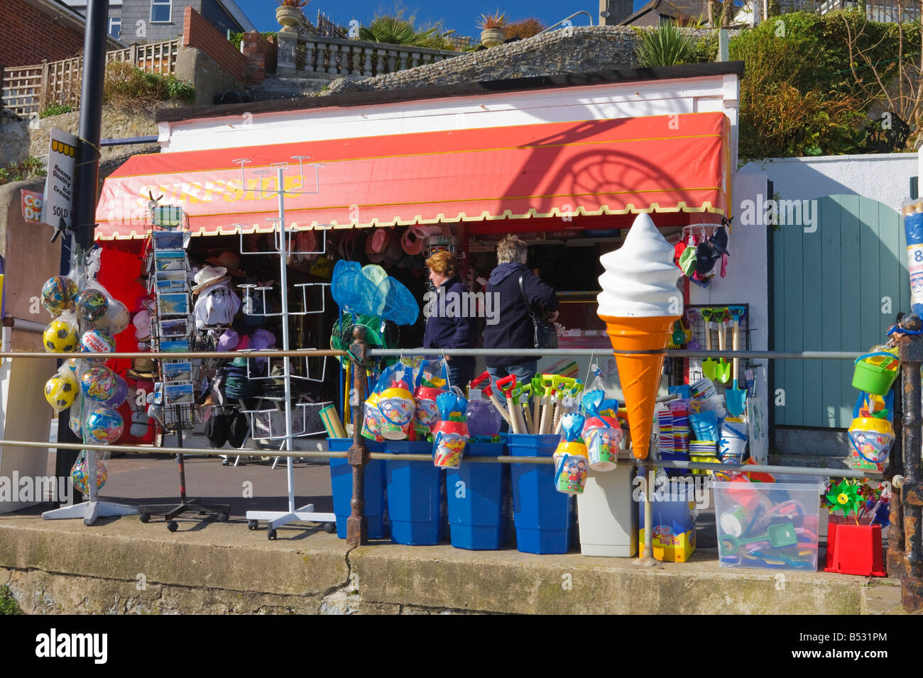 Shop on Lyme Regis Promenade selling a variety of beach Toys and souvenirs and Ice Cream - Stock Image