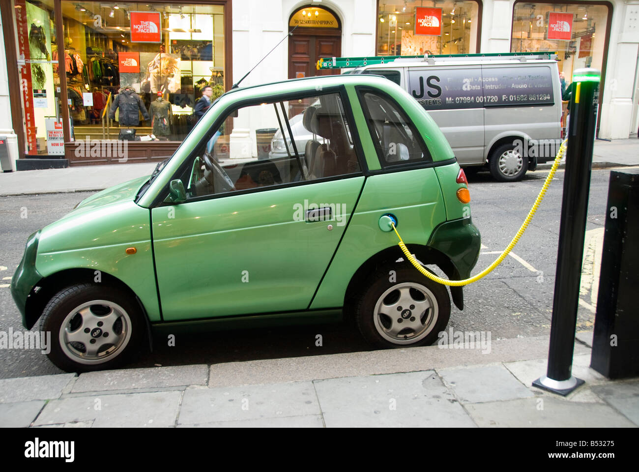 A G Wiz electric car charging from a City of Westminster Juice point in central London - Stock Image