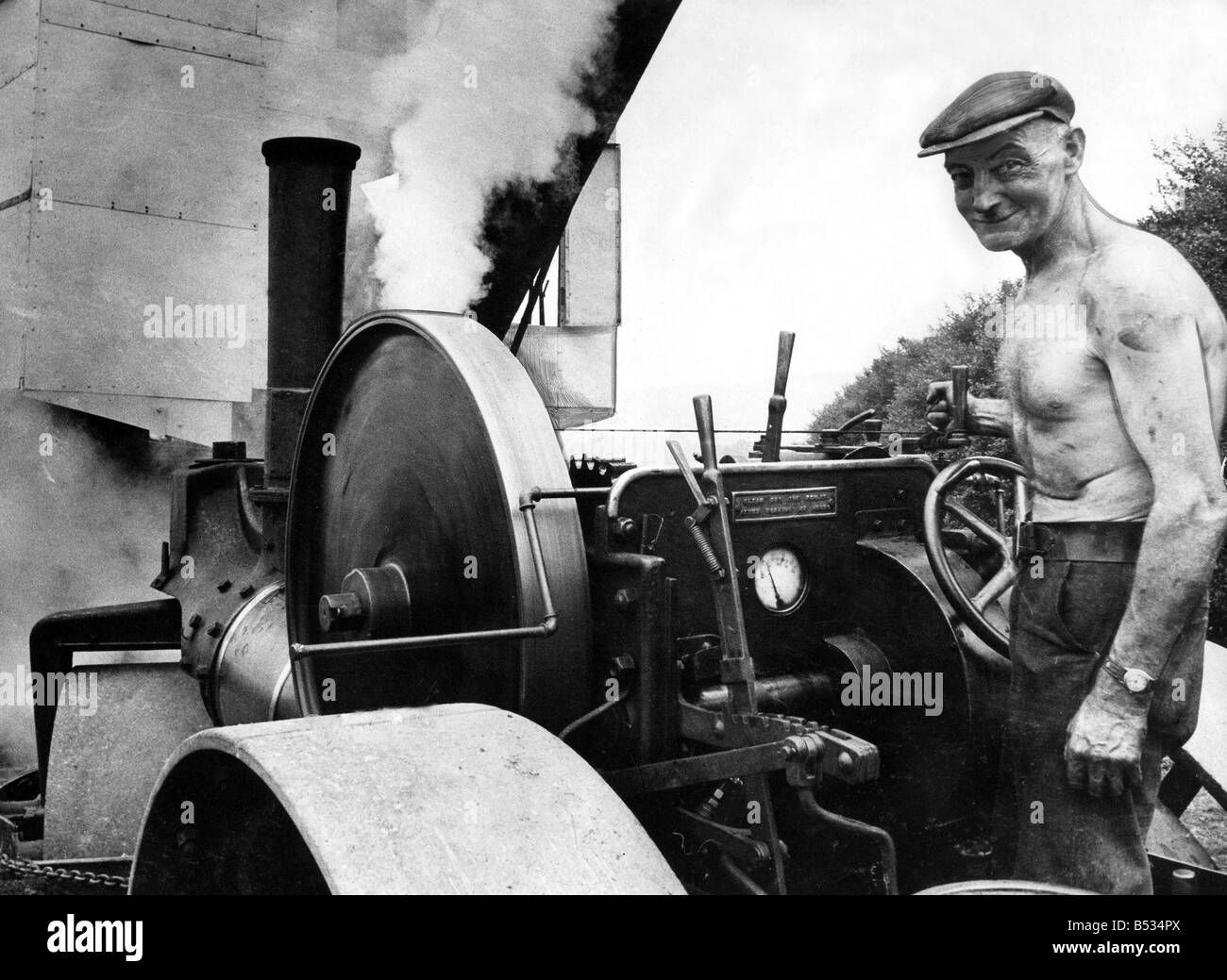 Driver Gerald Shortt and his steam roller at Beamish Open Air Museum - Stock Image