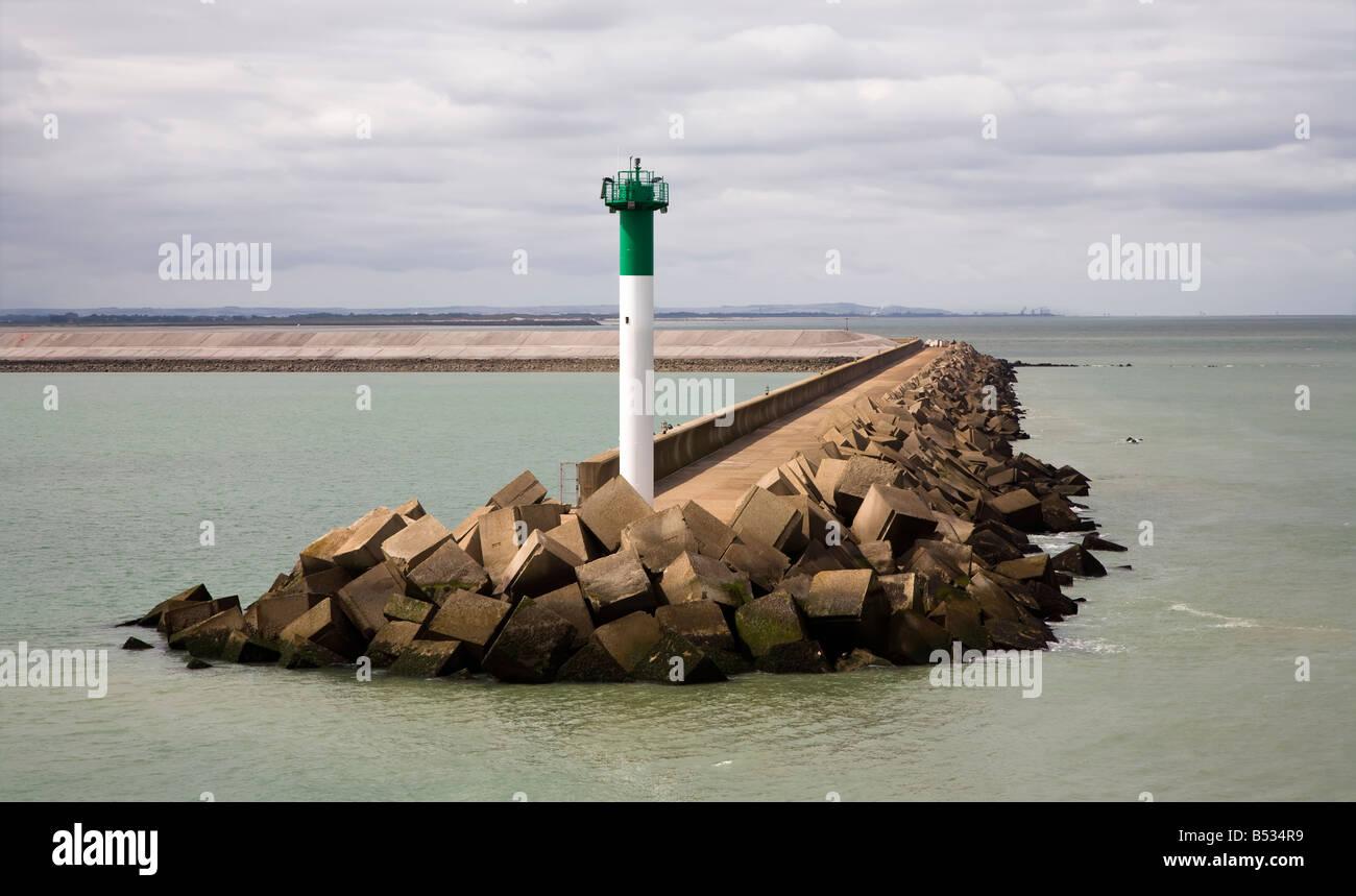 Warning light on harbour breakwater entrance Dunkirk France - Stock Image