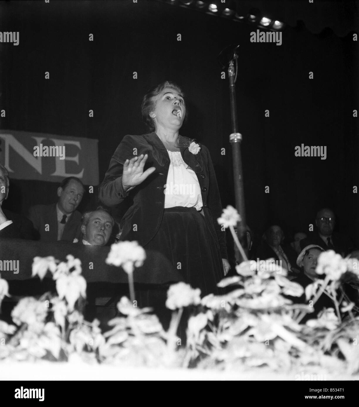 Labour Party Conference 1952;Jennie Lee addresses Tribune meeting Nye Bevan at her side and Harold Wilson in the - Stock Image