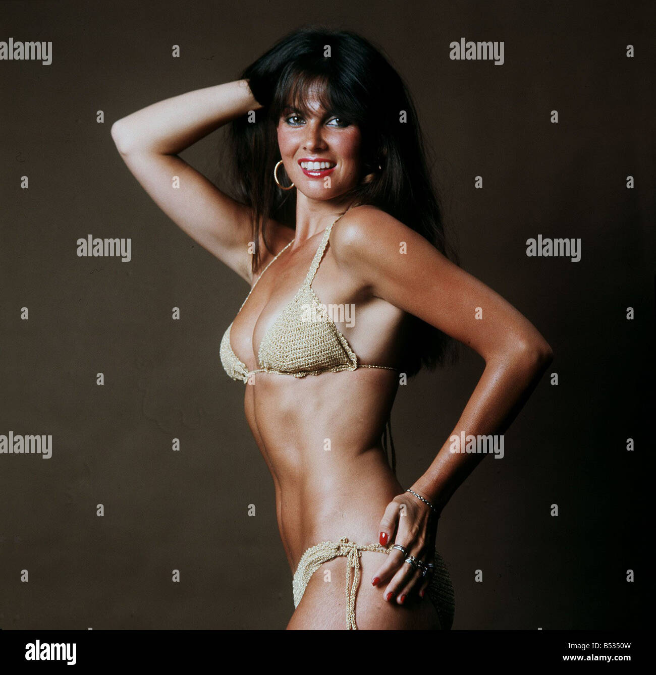 Actress Caroline Munro wearing gold bikini 1983 Played a James Bond girl in the film The Spy Who Loved Me - Stock Image