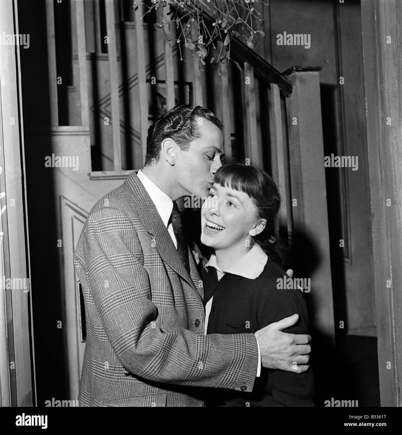 Mistletoe. Actor Barry Sinclair and Sally Lewis seen here in a scene from the play 'Friendly Relations'. - Stock Image