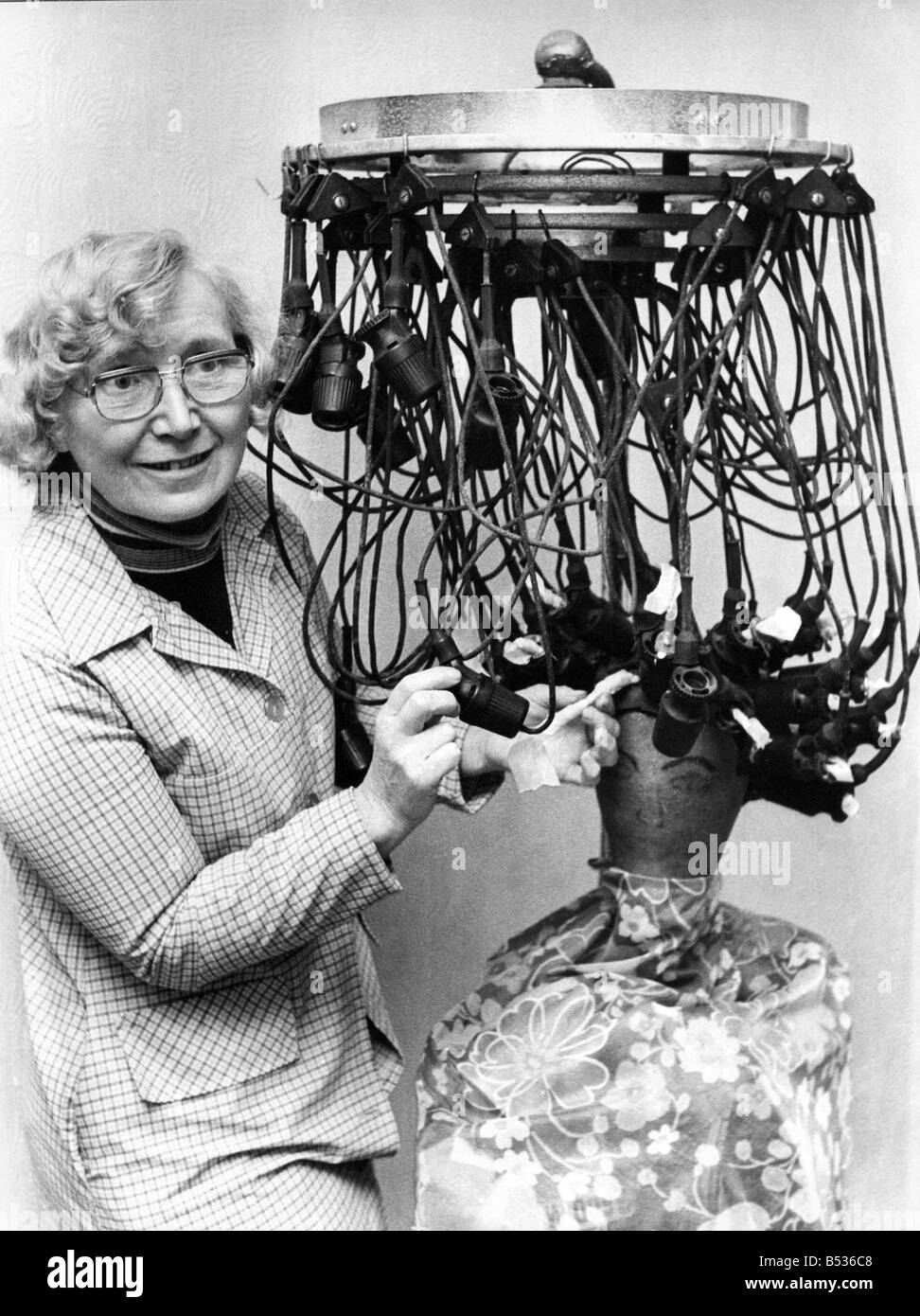 Irene Douglas with her strange looking antique permanent waving electrical outfit at Beamish Museum - Stock Image