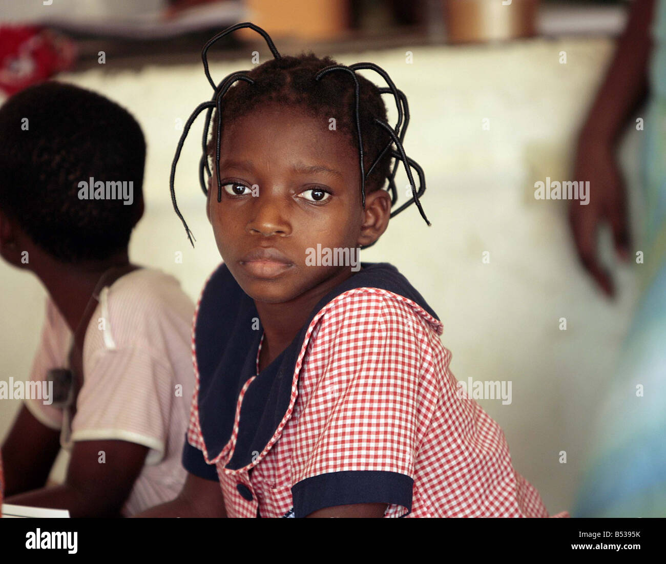 Child Slaves in Benin West Africa February 2007 Nine year old Afi tells how she was sent away from home to work - Stock Image