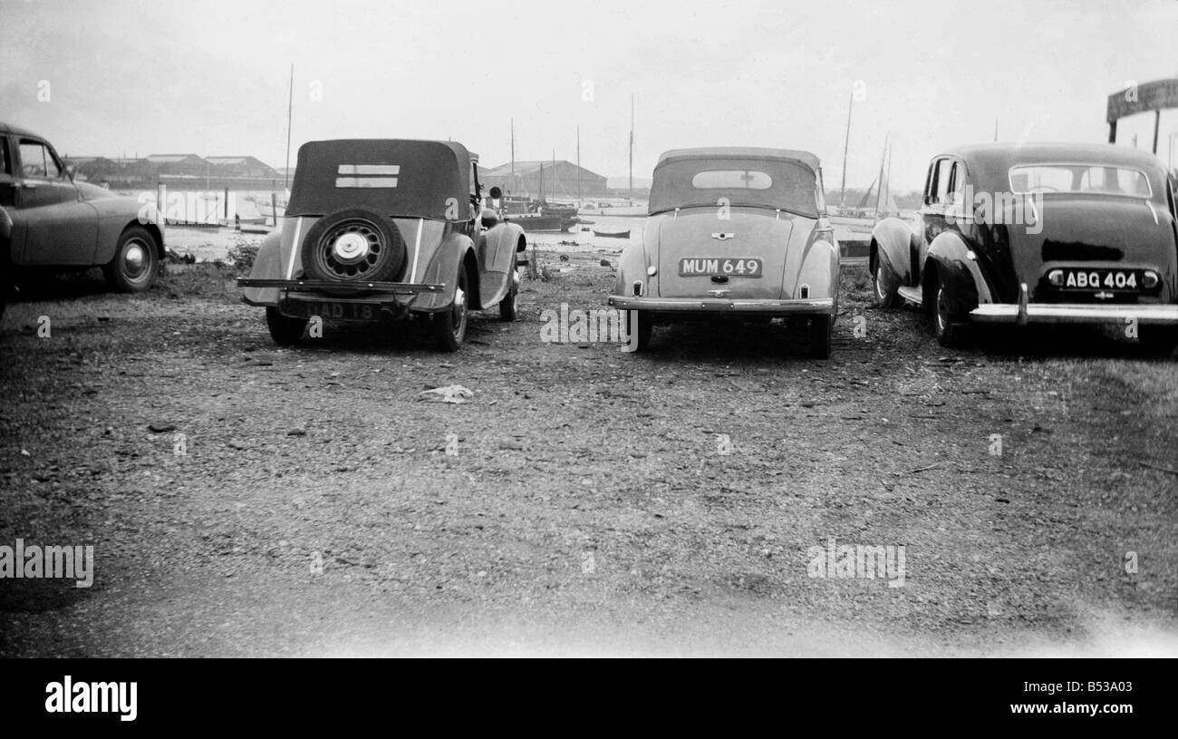 A car parked with the personalised number plate 'Mum'December 1952 C6201 - Stock Image