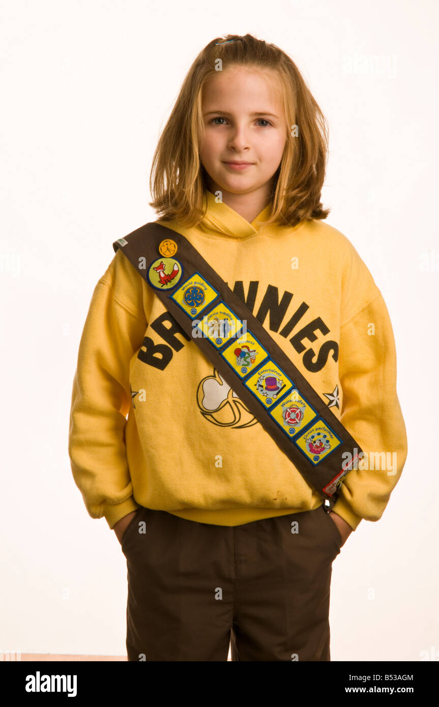 10 year old girl dressed in her Brownies uniform - Stock Image
