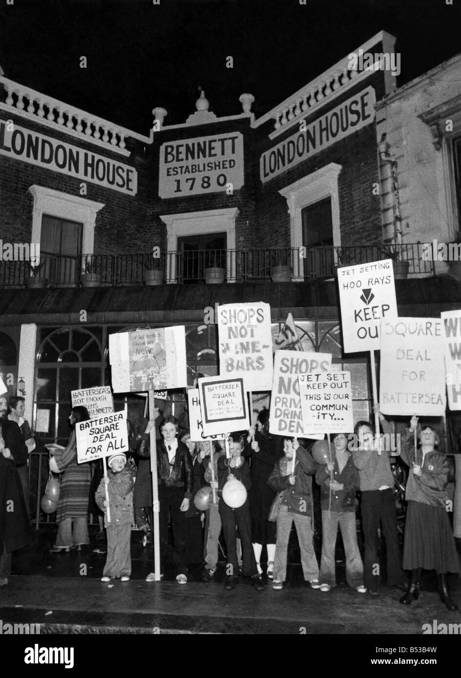 Demonstrators of all ages parade in front of the new club of Roddy Roddy Llewellyn. The square deal placards refer - Stock Image