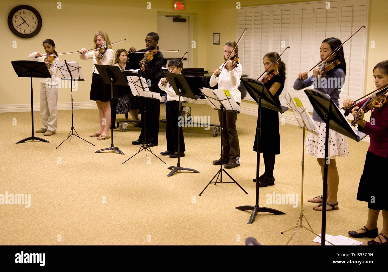 Group of Violin Students at Recital - Stock Image