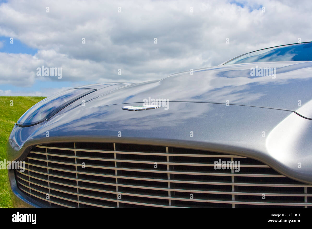 Bonnet And Grille Of A Silver Aston Martin Vanquish With Blue