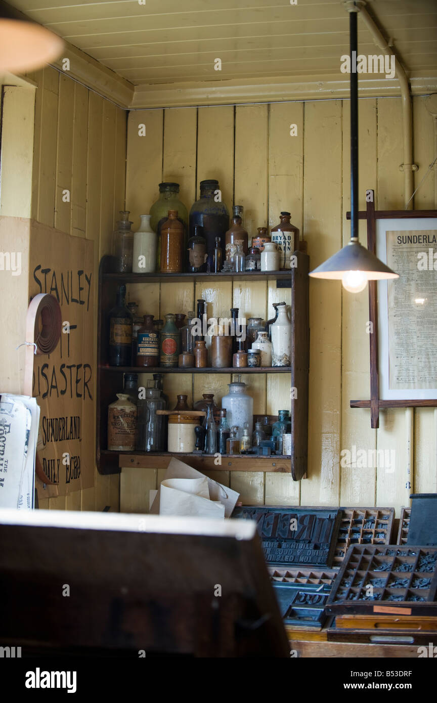 Bottles of Inks in the corner of an old print room - Stock Image