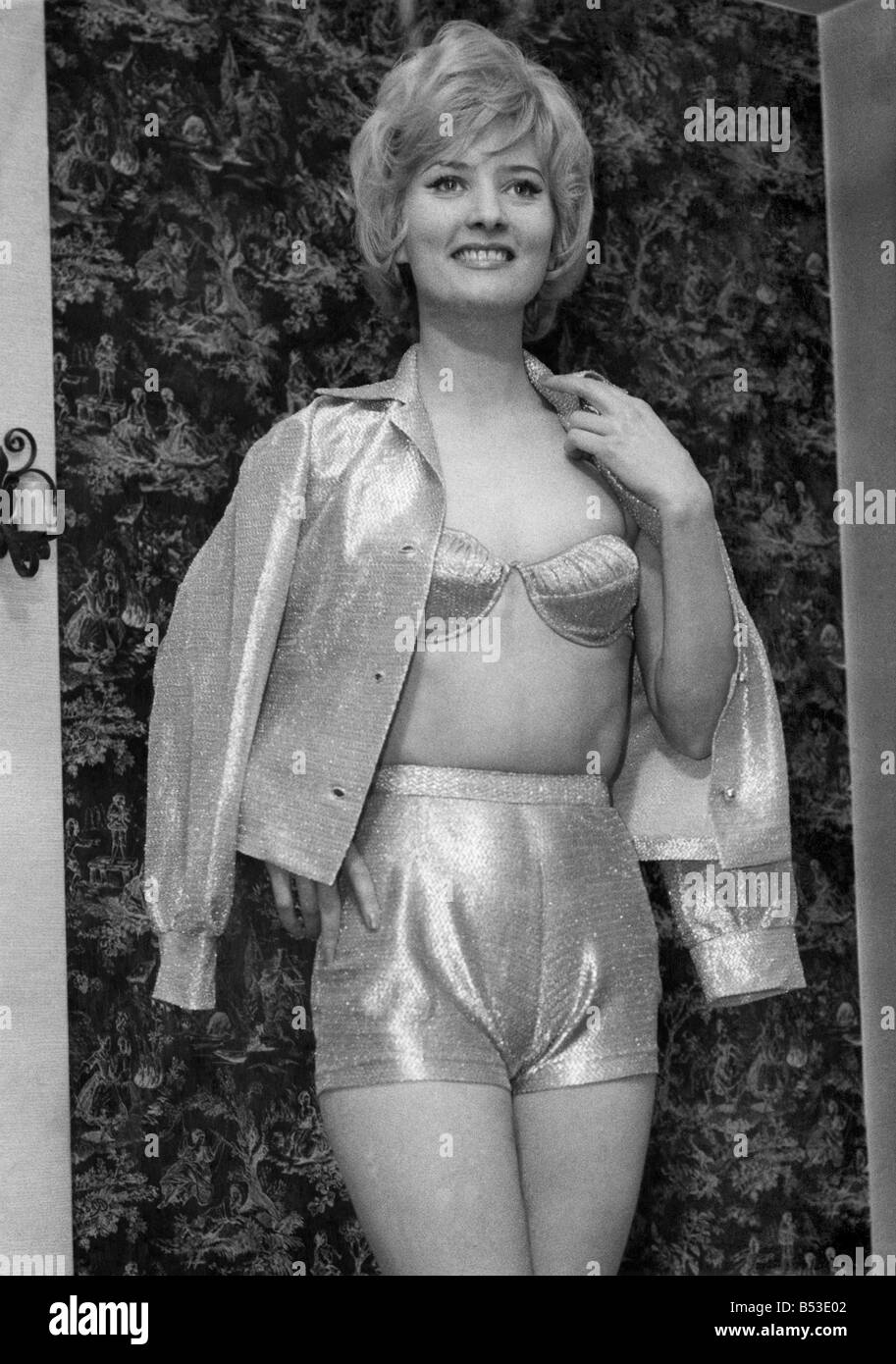 Clothing Swimwear: Shimmer me timbers! It's actress Pat Roberts, 22, pictured showing off a 1961 golden fabric - Stock Image
