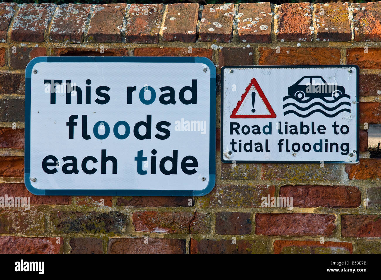 Amusing road signs - This road floods each tide & Road liable to tidal flooding - well , make up your mind Council Stock Photo