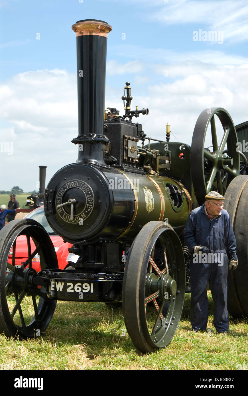 A man and his Ruston Proctor steam powered traction engine at Bloxham Vintage Vehicle and Country Show. UK. - Stock Image