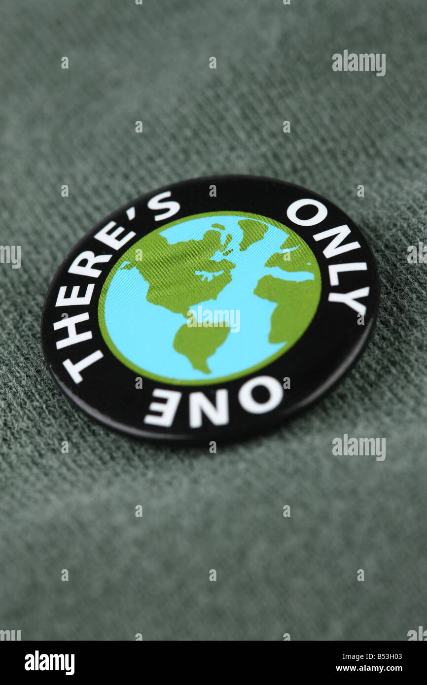 Close up of planet earth pin on shirt - Stock Image