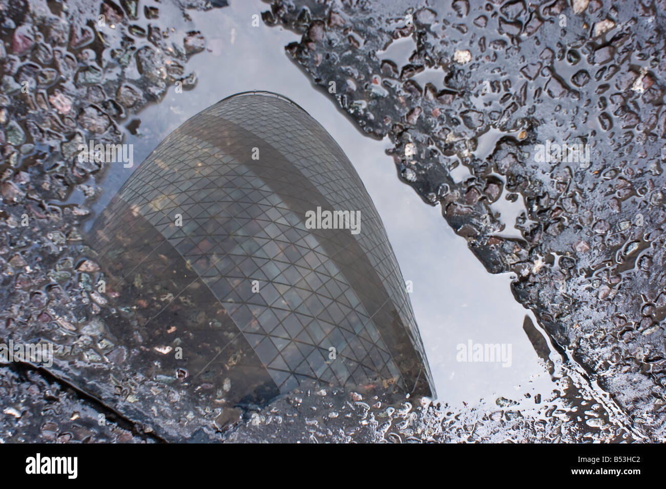 The Gherkin reflected in a puddle - Stock Image