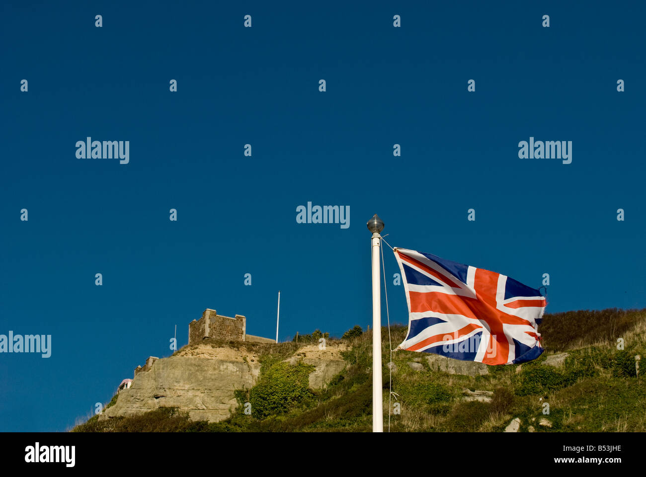 The Union Flag flying in Hastings with East Hill in the background. - Stock Image