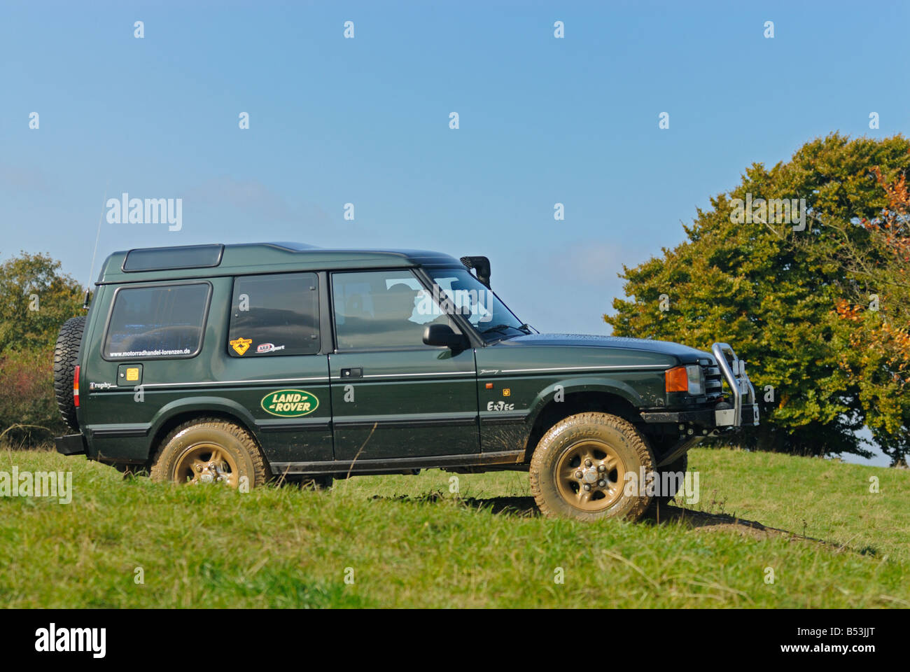 1990s Land Rover Discovery 1 on a forest track in the hilly Weserbergland. - Stock Image