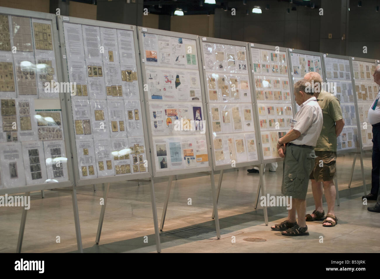 Stamp collectors admire collections at an American