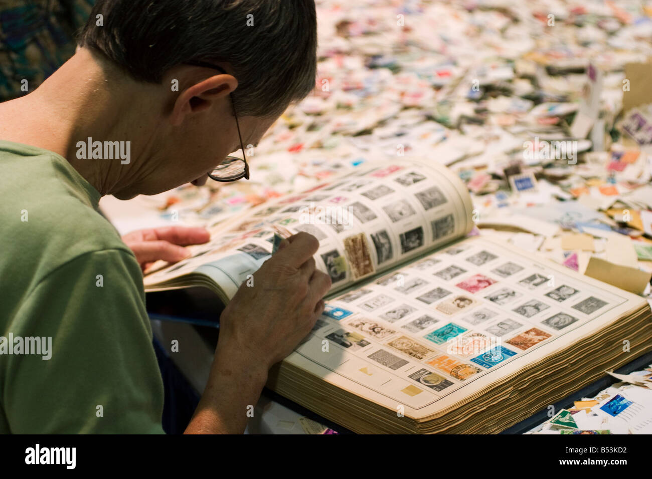 Stamp collector peruses stamps for sale at a bargain booth