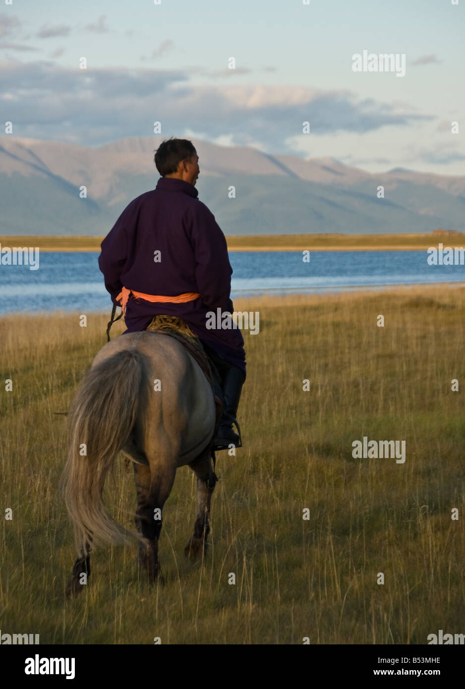 Nomad riding his horse North Mongolia - Stock Image