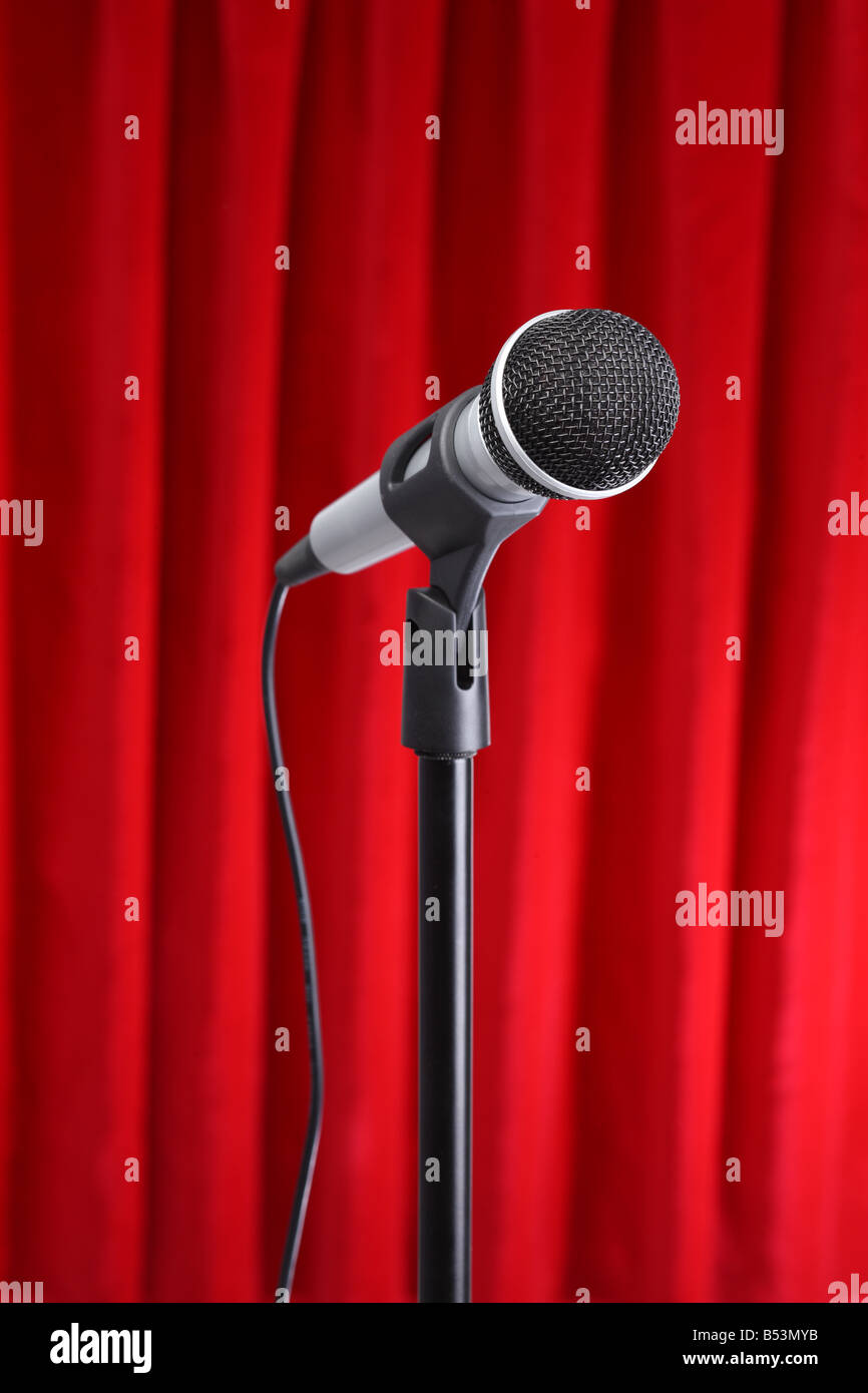 Microphone with red curtain background - Stock Image