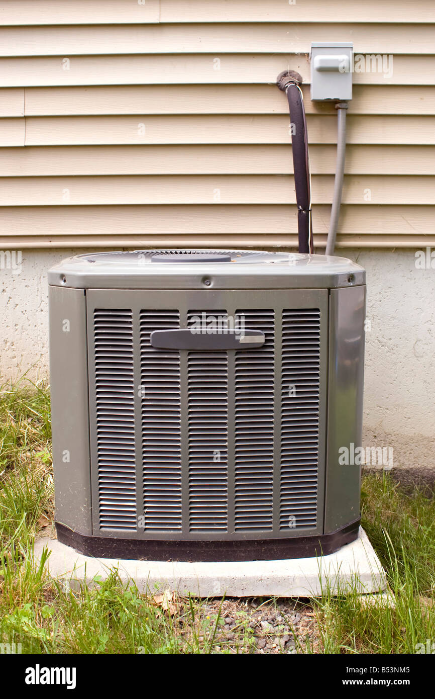 a residential central air conditioning unit sitting outside - Central Air Conditioning Unit