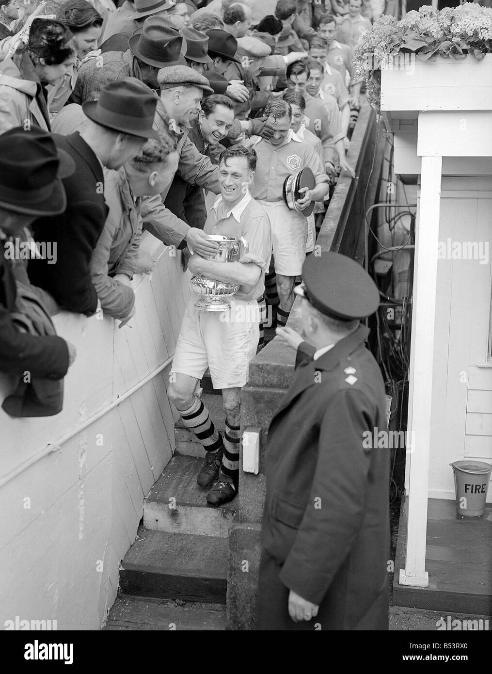 Joe Mercer walks down from the Royal Box at Wembley after collecting the FA Cup for Arsenal DM 023836 12 Stock Photo
